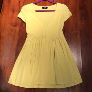Light yellow low-V T-shirt dress by Nasty Gal